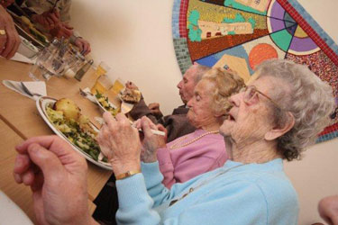 Local residents enjoying a hot meal at the Lunch Club.